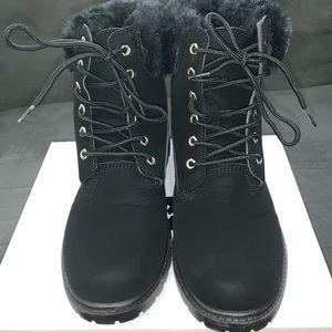 Black suede combat boots with fur